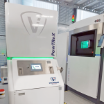 Photo demonstrating additive manufacturing system with PowTReX and 3D printer